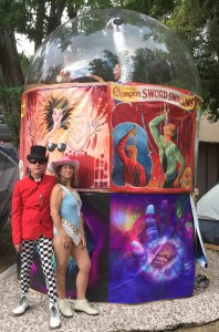 SkullDougery and his assistant, Sandra, pose in front of the Love Mirage.
